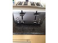 Nearly new 4 slices toaster for sale