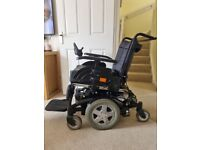 Invacare TDX SP2 electric wheelchair with vehicle ramp