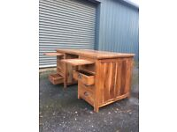 Hard wood desk with deep draws and a removable desk top