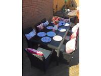 8 seater rattan table and chairs brand new cost £900