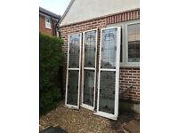 Three large Art Deco leaded windows,