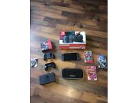 Brand new Nintendo switch in box 4 games carry case and 2 hand conrollers