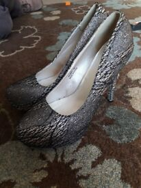 Size 7 black and gold heels