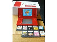 Nintendo Dsi Red plus 10 games toy story/lego