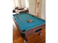 American pool table complete with professional cue and balls