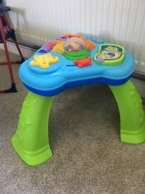 Various children's item, activity table, sit to stand star and baby walker