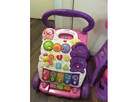 Baby Walker,bath tub and toys very good condition pick up from Hounslow.
