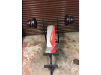 Weight training bench with vinyl weights
