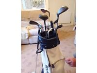 Full set of McGregor golf clubs plus 1 rescue club and chipper, bag included. Very good condition.