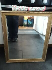 Gold-effect mirror with decorative frame