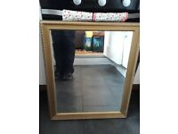 Gold-effect mirror with decrative frame