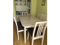 Dining table and 6 chairs. Table does extend. Light solid wood finish. Excellent condition. £240.