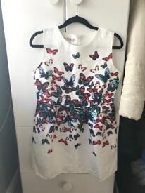 New mini dress without tags, size M/L (10-12)