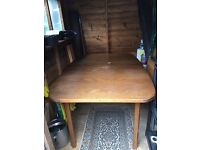 Large extendable dining table + 4 matching chairs for free