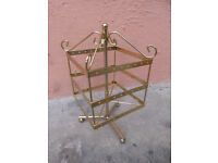 East Belfast area. Ear ring / jewellery stand Rotating stand, gold colour. Sturdy metal construction