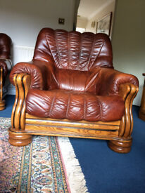 Solid oak armchair with leather upholstery
