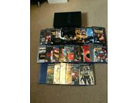 PS2, 29 Games, 1 Control and an 8mb Memory Card.