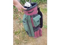 Red and green golf bag with a few clubs