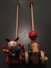 Two Push along wooden toy