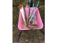 Garden tools rake three edge trimmers and saw