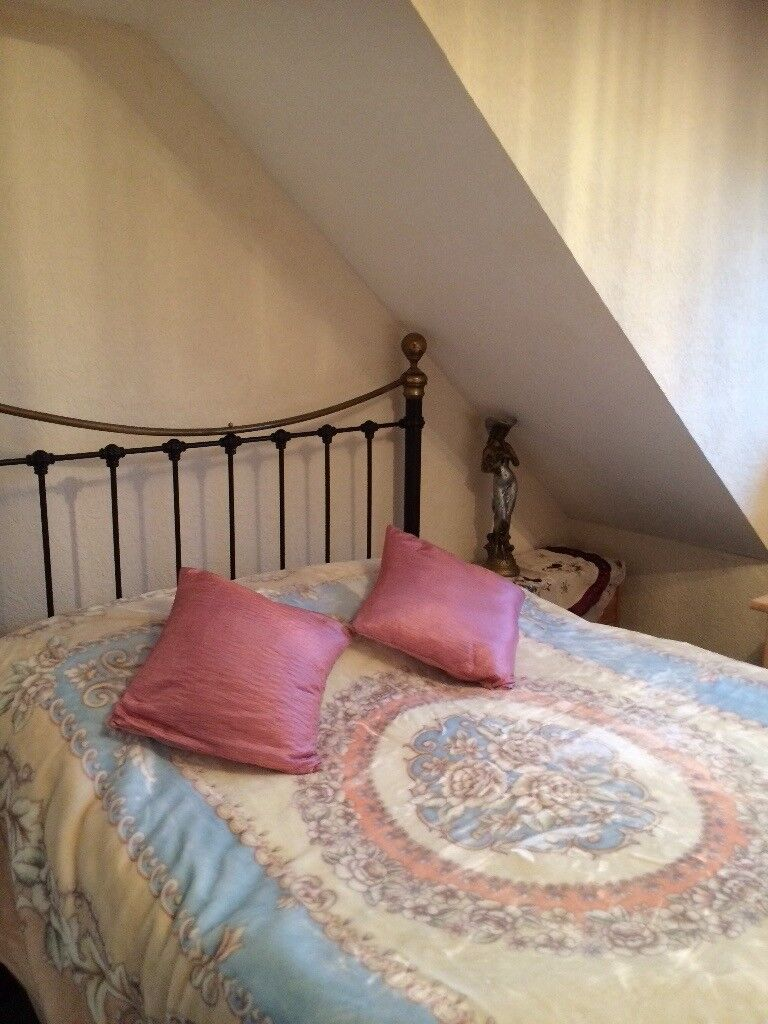 Two women decoraiting rooms and kitchens,includind wallpaper,painting,design furniture.