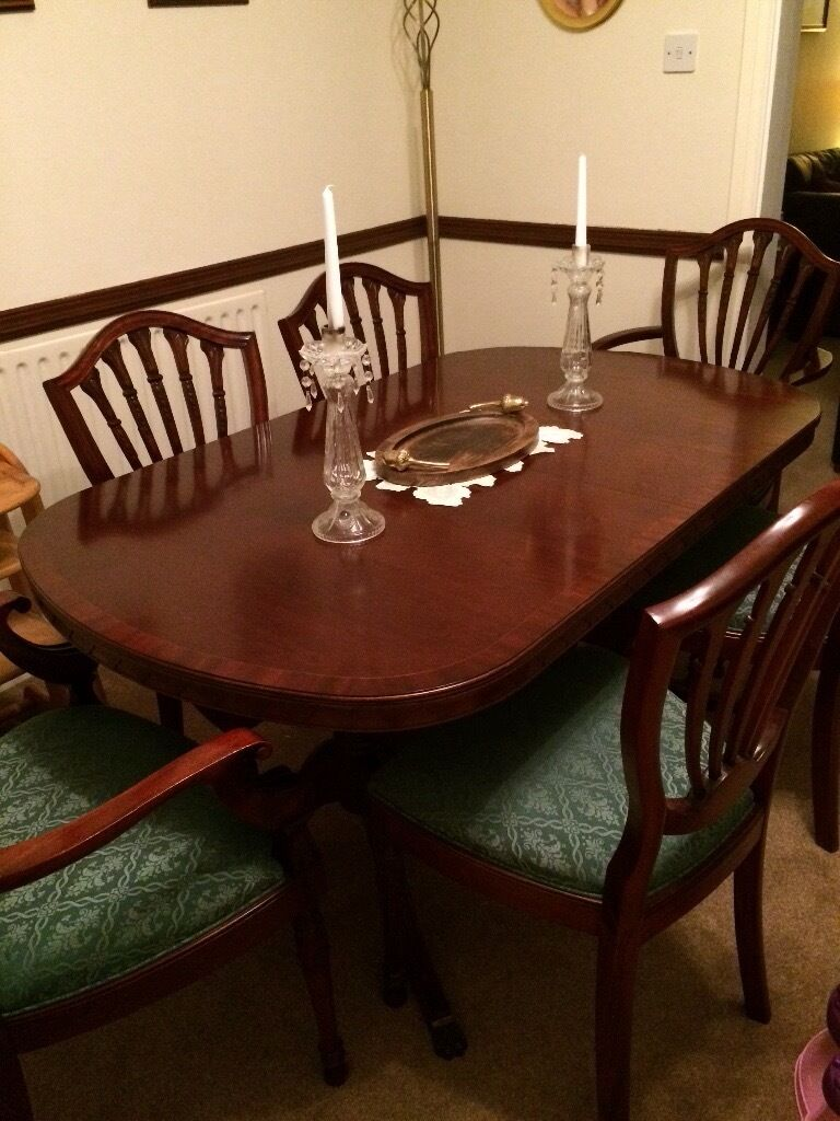 Ft mahogony dining table and for chairs in hollywood