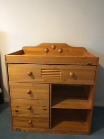 Wooden baby changing table, 4 drawers, 2 shelves. Good condition, smoke free, pet free home