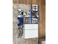 PS4 2 controllers and 5 games immaculate condition
