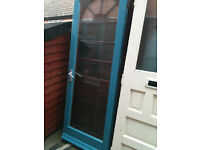 Exterior door with large ribbed glass panel