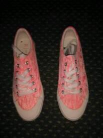 Pink plimsoles