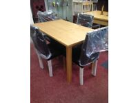Brand new table with 4 chairs