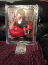 Signed and framed mike Tyson glove