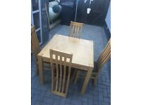 Solid wooden table & 4 leather chairs - excellent condition