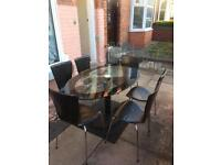 glass dining table with 6 leather chairs good condition