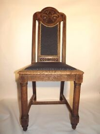 Refurbished oak chair with carved dragon detailing