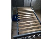 Metal frame single bed. Slats on base with 1 missing but doesn't effect the use of the bed