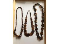 Set of three brown necklaces