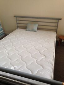 Double bed with metal frame.....
