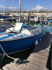 Small boat available to rent for lodgings at Brighton Marina