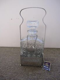 Glass decanter in silver plated stand