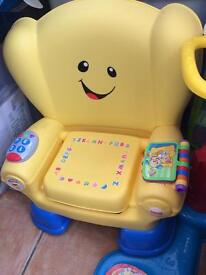 Fisher-Price laugh and Learn smart chair.