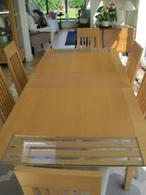 Extending beech dining table and 6 high back chairs
