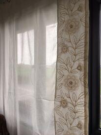 Lovely off white/cream semi sheer tab top full length curtains