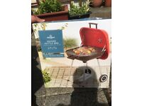 Barbecue charcoal trolley