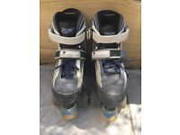 Child's SFR Typhoon quad roller skates boots, adjustable size 12-2 with pads