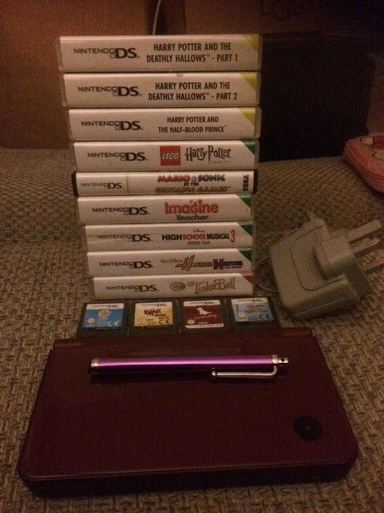 Nintendo ds xl with 13 games stylus pen and charger in plum