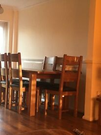 Solid oak extending table and 6 chairs only 1 year old never used