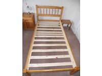 Two pine single beds with mattresses