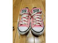 Converse All Star pink shoes.