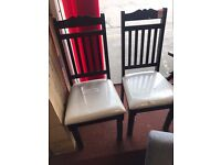A pair of solid oak high quality chairs Walnut colour
